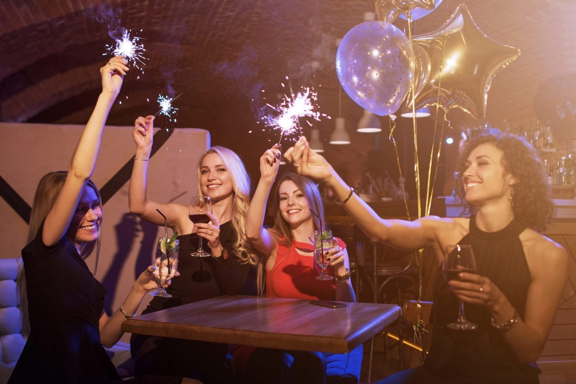 Girls partying at a spark with sparklers